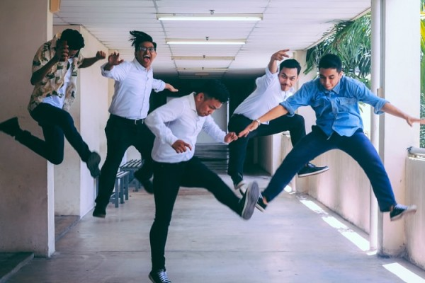 A group of people doing jump shot photography